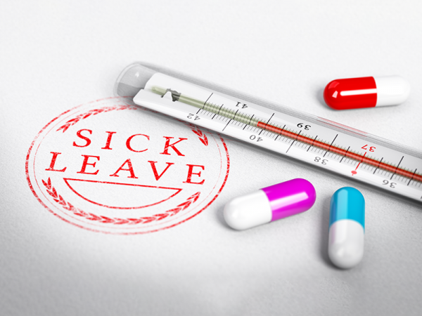 A stamp with the words Sick Leave in red and two red laurels above and below it in a circle, a thermometer, and three pills.