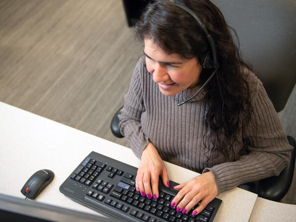 Call center employee working at a computer