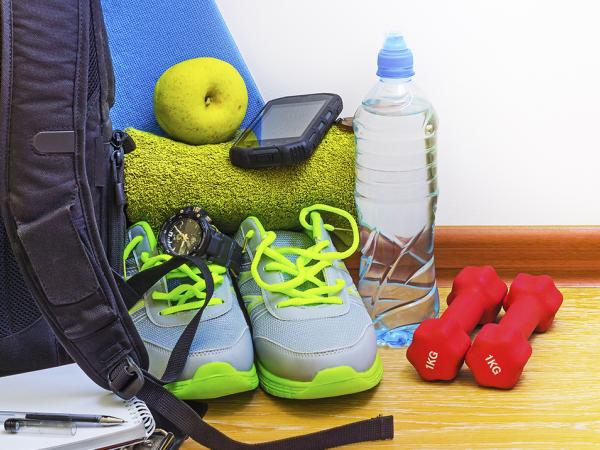 Gym bag with shoes, weights, water bottle and towel
